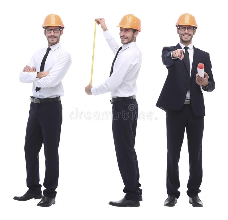 In full growth .successful architect engineer in orange helmet. royalty free stock photos