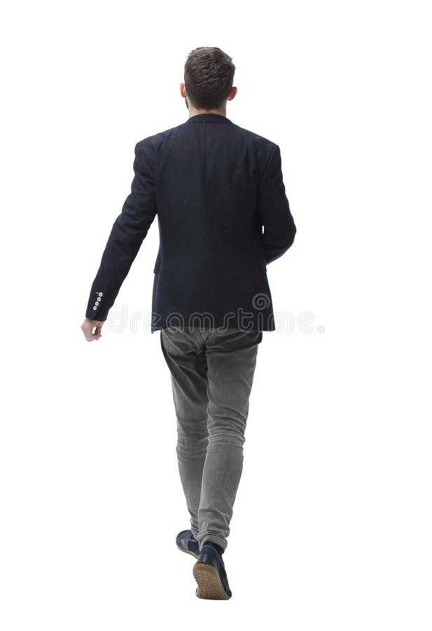 In full growth. successful modern man confidently stepping forward royalty free stock image