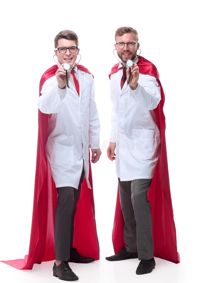 In full growth. super doctors showing their stethoscopes. Isolated on white stock photography