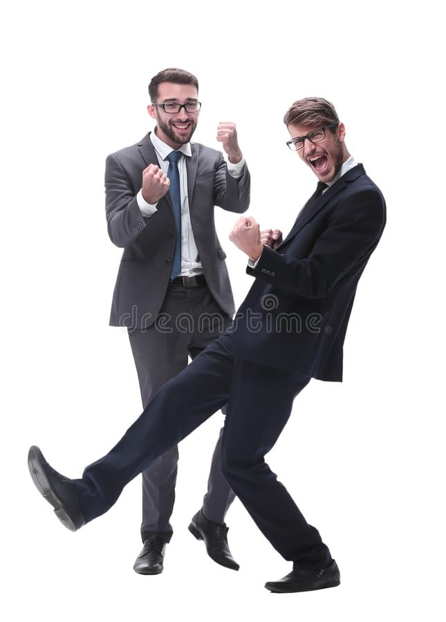 In full growth. two happy dancing young businessmen royalty free stock photos