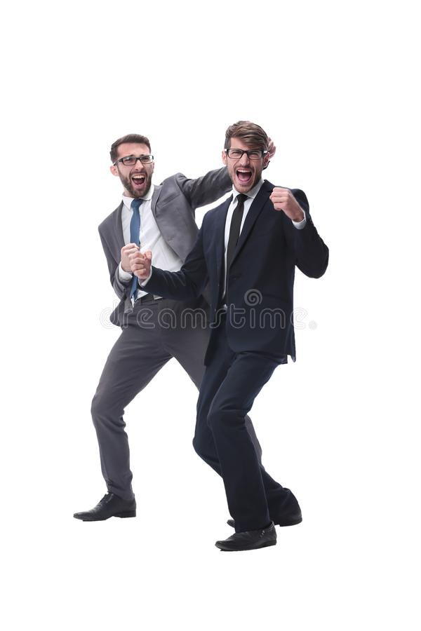 In full growth. two happy dancing young businessmen royalty free stock photography