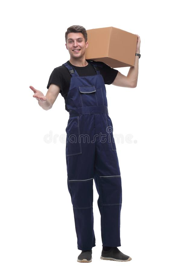Work in overalls with a cardboard box on his shoulder. isolated on white royalty free stock photos