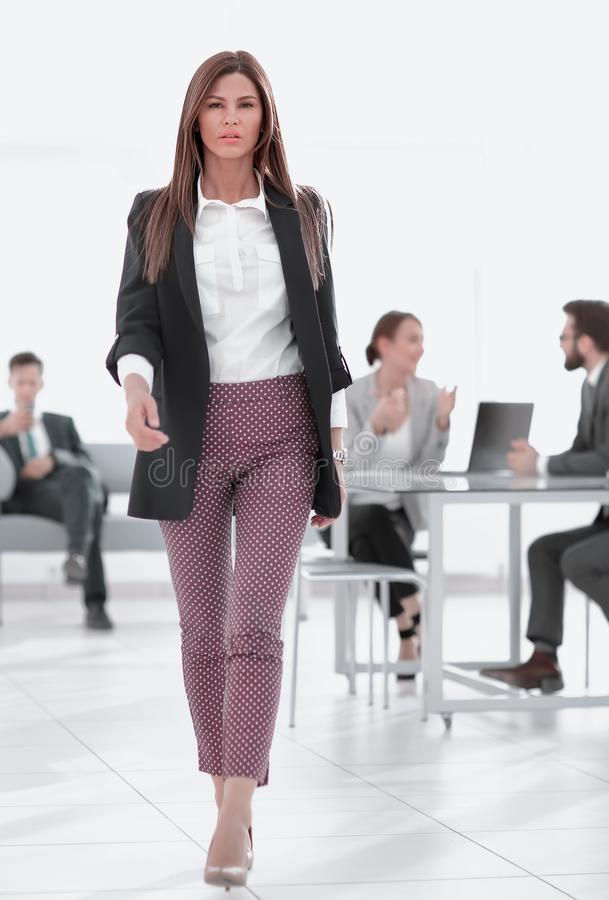 In full growth.young business woman on the background of the office royalty free stock photo
