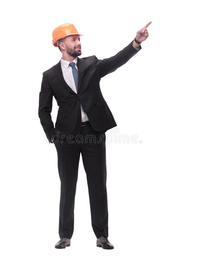 In full growth. young businessman in helmet pointing to copy space stock image