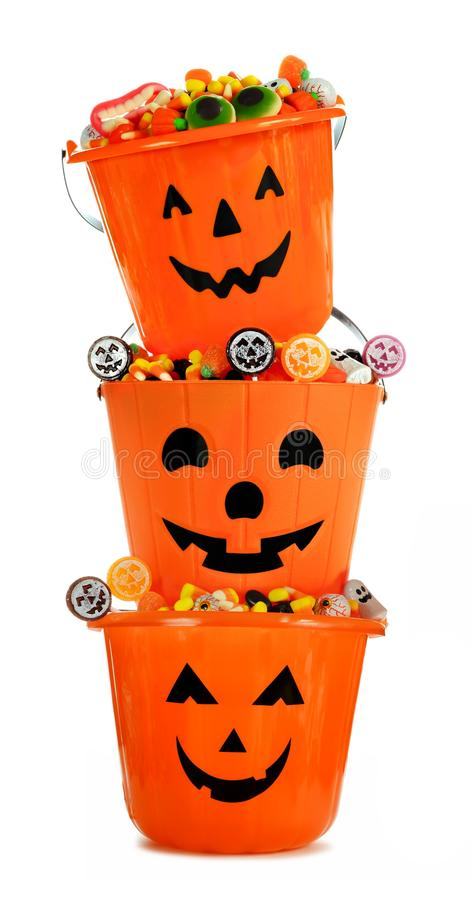 Full Halloween Jack o Lantern candy holders stacked over white royalty free stock images