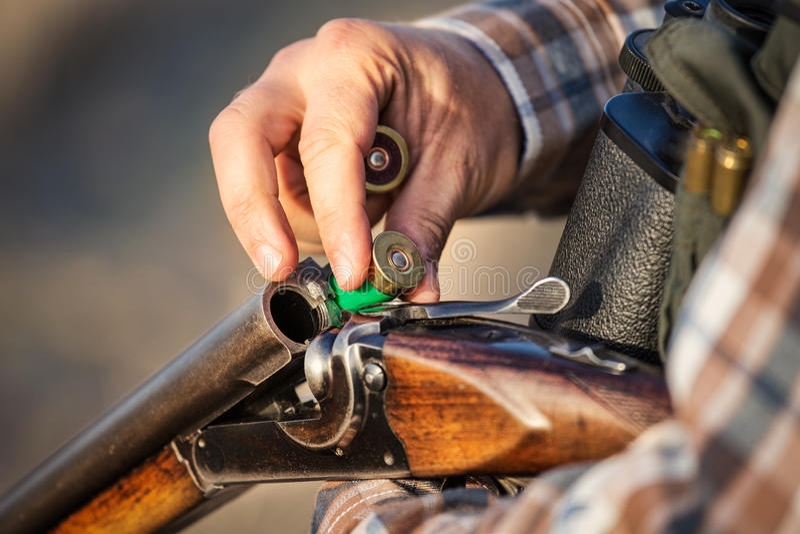 Full hunter hunting rifle royalty free stock image
