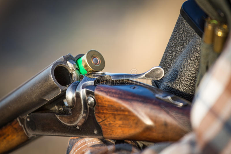 Full hunter hunting rifle royalty free stock photography