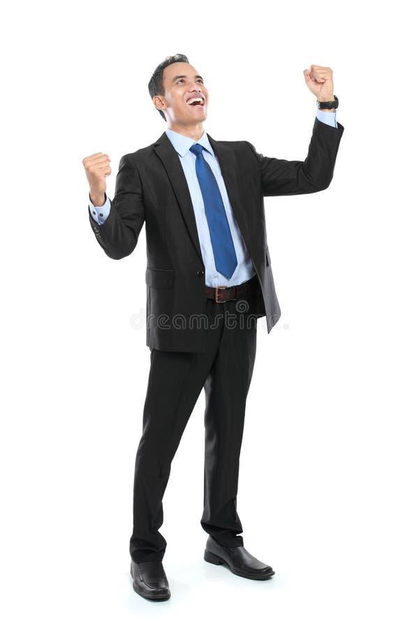 Full kropp av den jätteglade lyckade göra en gest affärsmannen royaltyfria foton