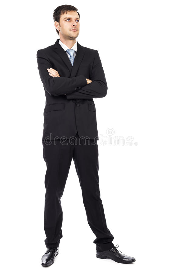 Full kroppstående av den unga affärsmannen med vikta armar royaltyfri foto