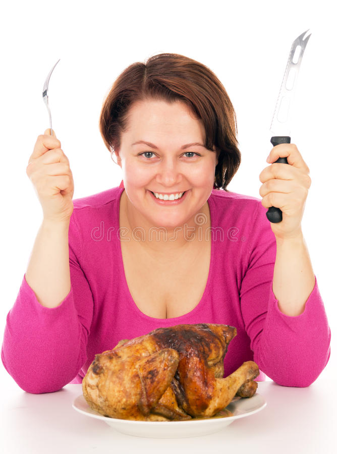 Full kvinna på en banta som är klar att äta höna royaltyfri bild