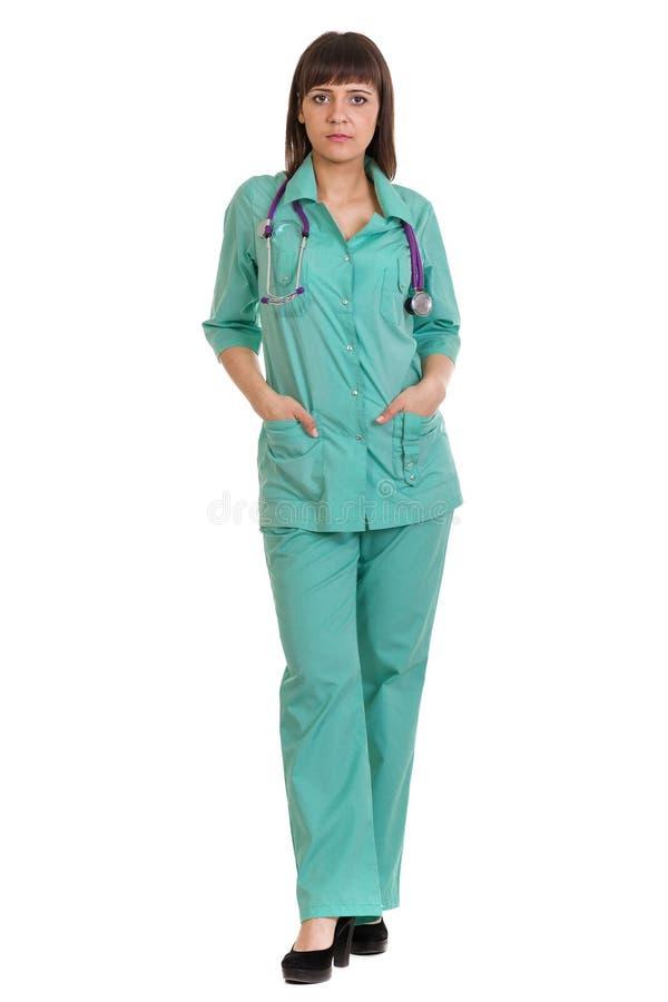 Full längd av den isolerade allvarliga kvinnliga medicinska doktorn royaltyfria foton