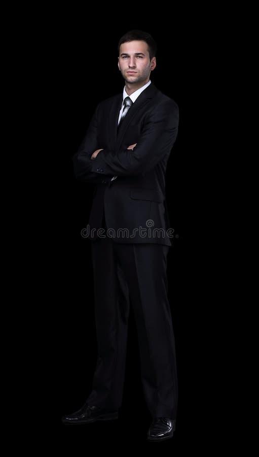 Full längd av ungt lyckat le för chef som isoleras på svart fotografering för bildbyråer