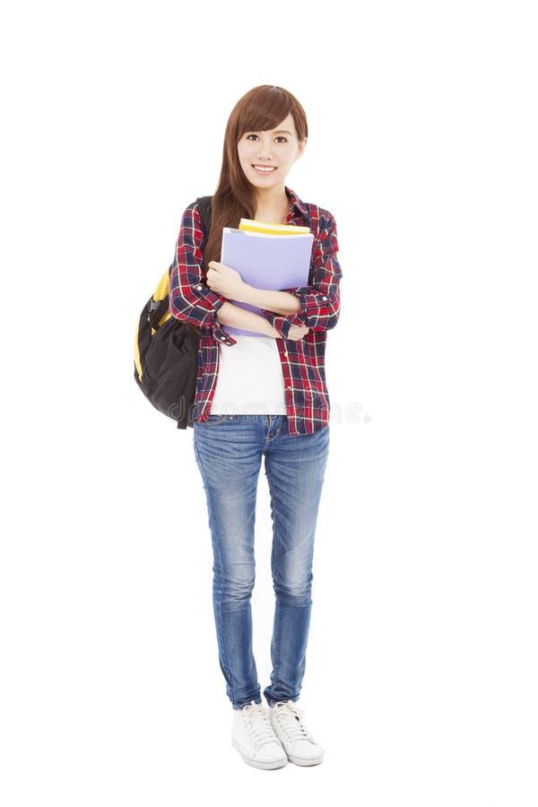 Full längd som ler universitetsstudentflickaanseende royaltyfri fotografi