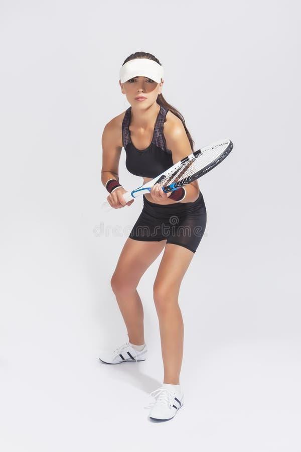 Full längdstående av den nätta idrotts- kvinnliga professionelln Tenn arkivfoto