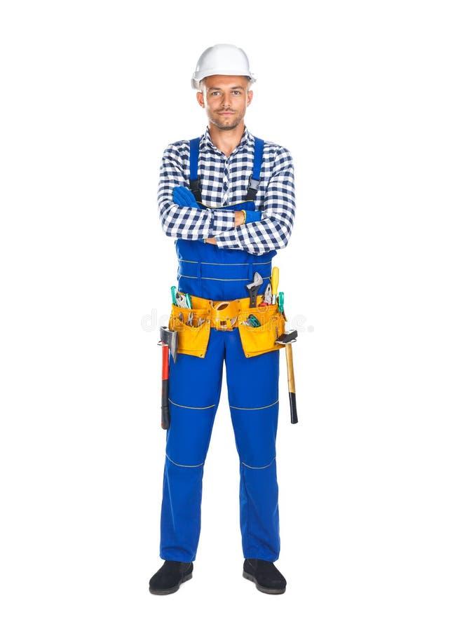 Full längdstående av den säkra byggnadsarbetaren i likformig royaltyfria foton
