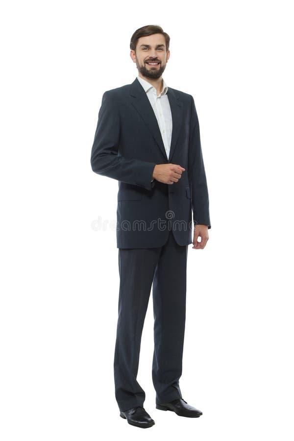 Full längdstående av den säkra unga affärsmannen royaltyfri foto