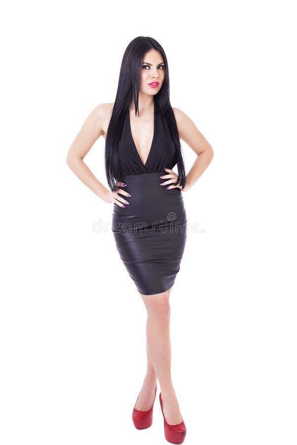 Full längdstående av den sexiga unga brunettkvinnan royaltyfria bilder