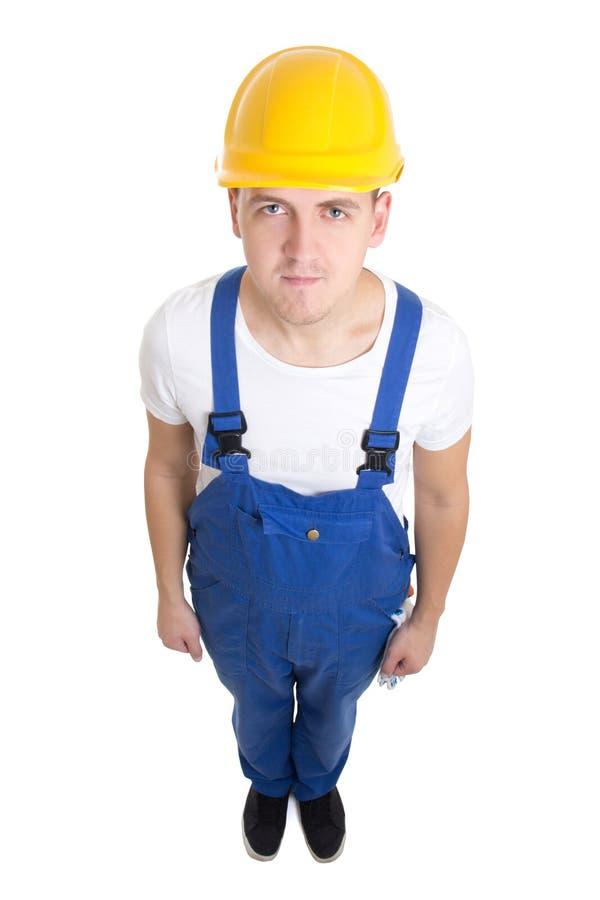 Full längdstående av den unga stiliga manbyggmästaren i blå unifo royaltyfria foton