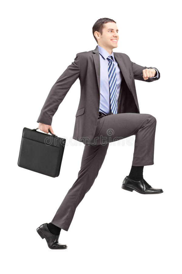 Full längdstående av en affärsman som gör ett enormt moment in mot fotografering för bildbyråer