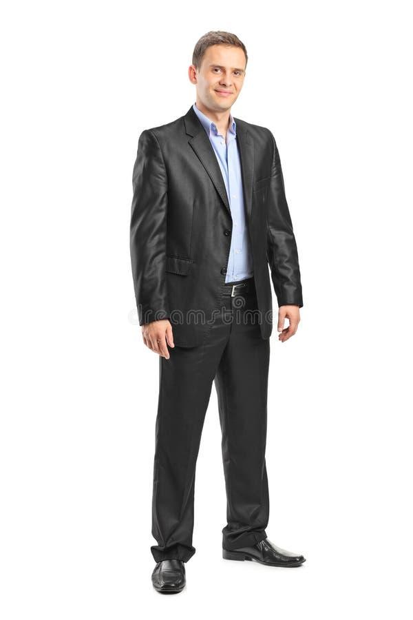 Full längdstående av en elegant man royaltyfria foton