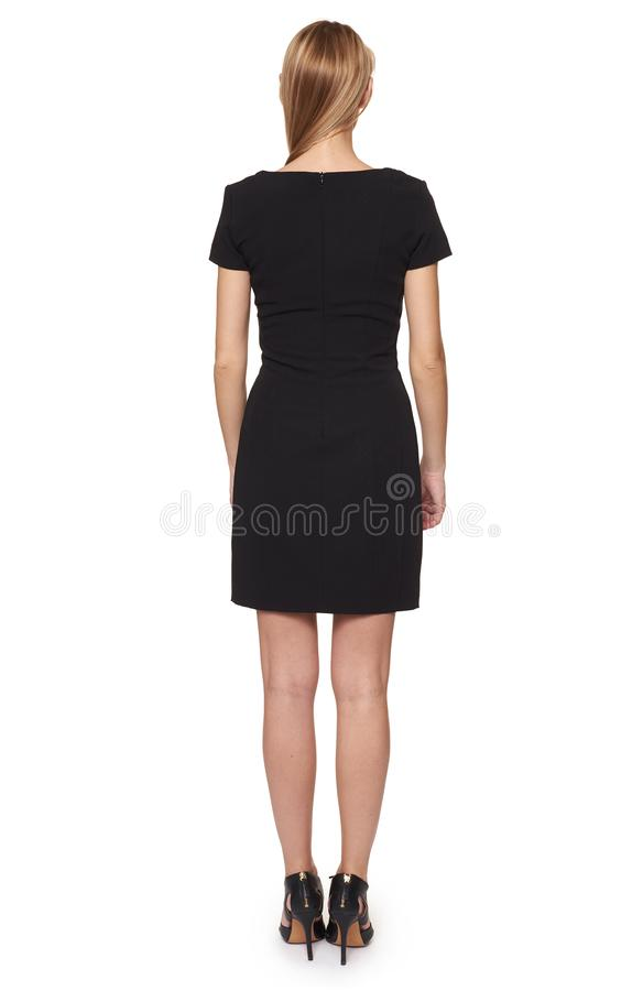 Full längdstående av en kvinna i svart klänning tillbaka sikt isolerat royaltyfria bilder
