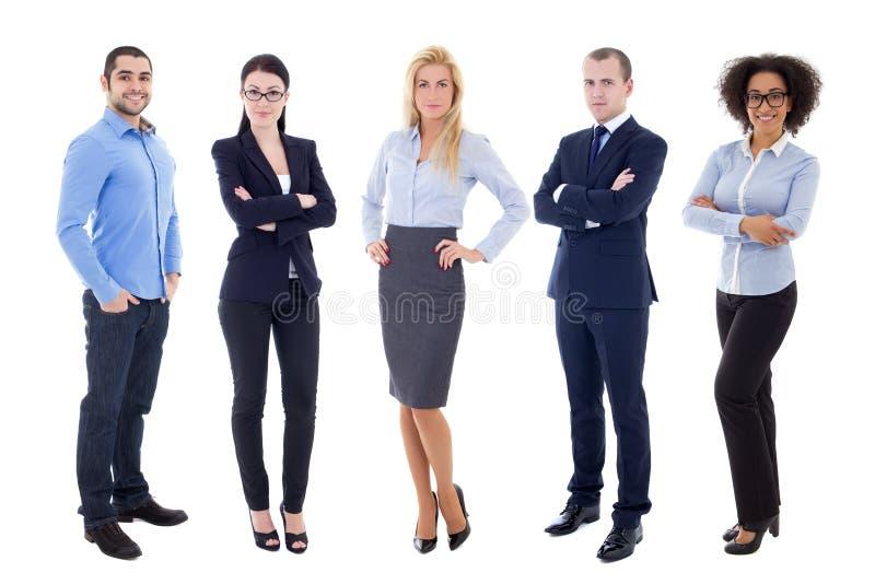 Full längdstående av ungt affärsfolk som isoleras på vit arkivbild
