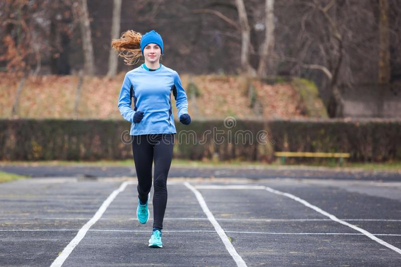 Full lenght shot of a young woman running. royalty free stock photos