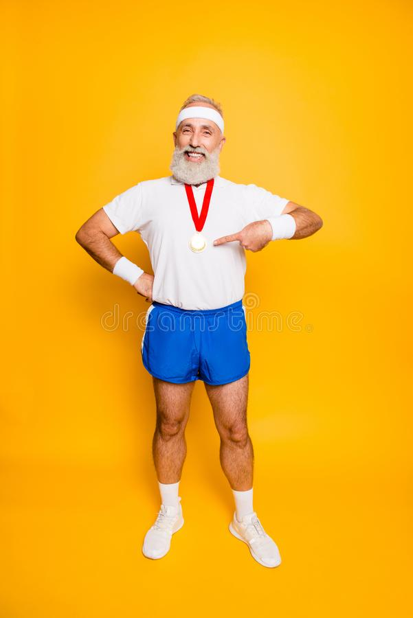 Full length of active cool funny competitive grandpa showing off stock photo