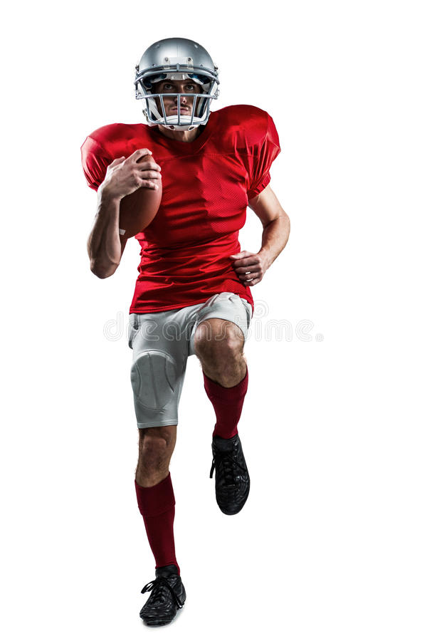 Full length of American football player in red jersey running stock photo