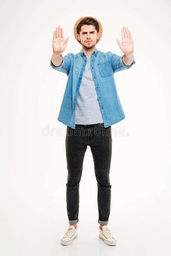 Full length of angry man standing and showing stop gesture royalty free stock photography