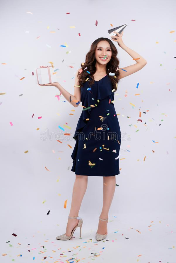 Full length of asian woman celebrating holding gift box with con royalty free stock photos