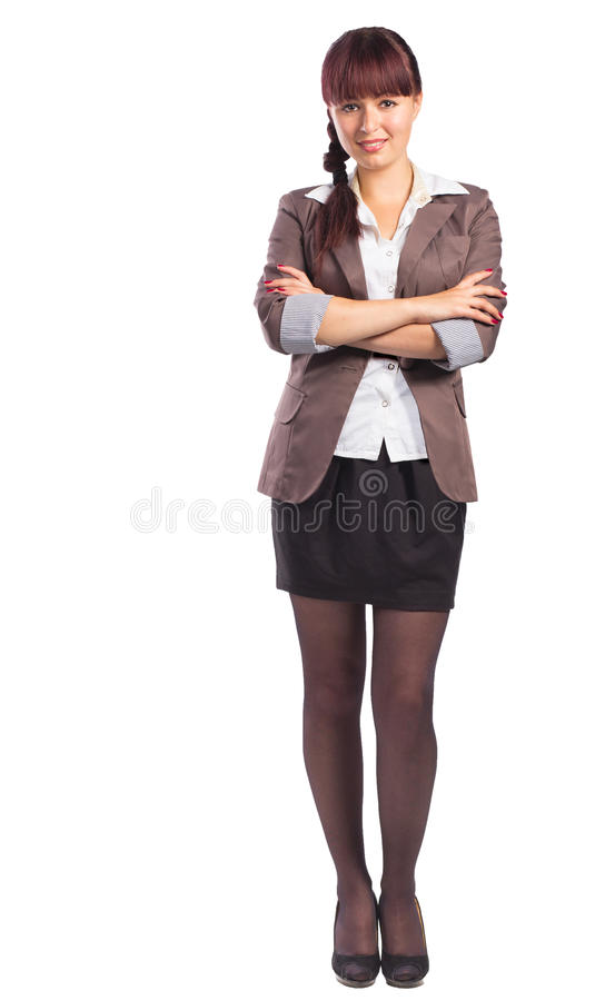 Full length of beautiful business woman standing with arms folde. Full length of smiling business woman standing with arms folded isolated on white background royalty free stock photos