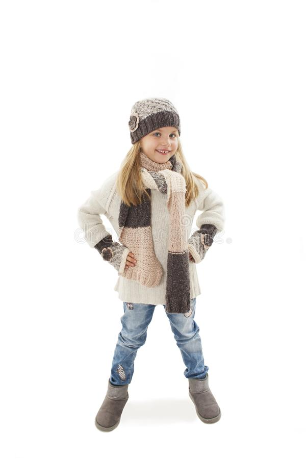 Full length of beautiful caucasian blonde fashionable girl in warm clothes, smiles. Winter style. royalty free stock photos