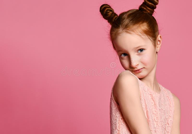 Full length of beautiful little girl in dress standing and posing over pink background stock photo