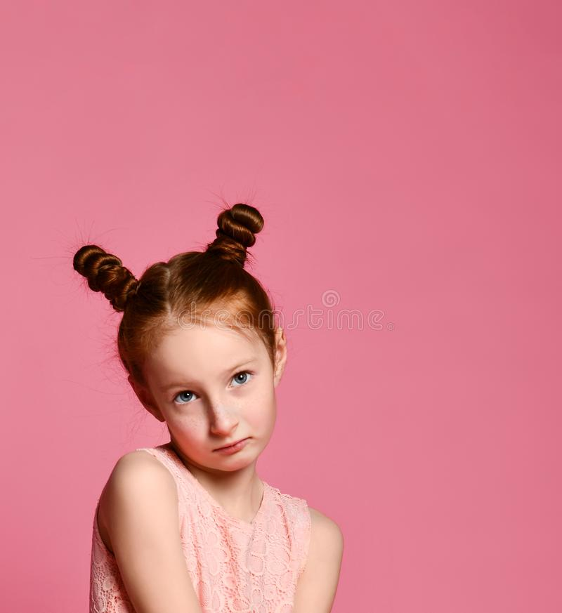 Full length of beautiful little girl in dress standing and posing over pink background royalty free stock image