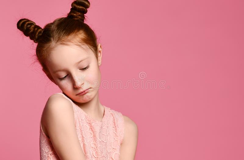 Full length of beautiful little girl in dress standing and posing over pink background royalty free stock photos