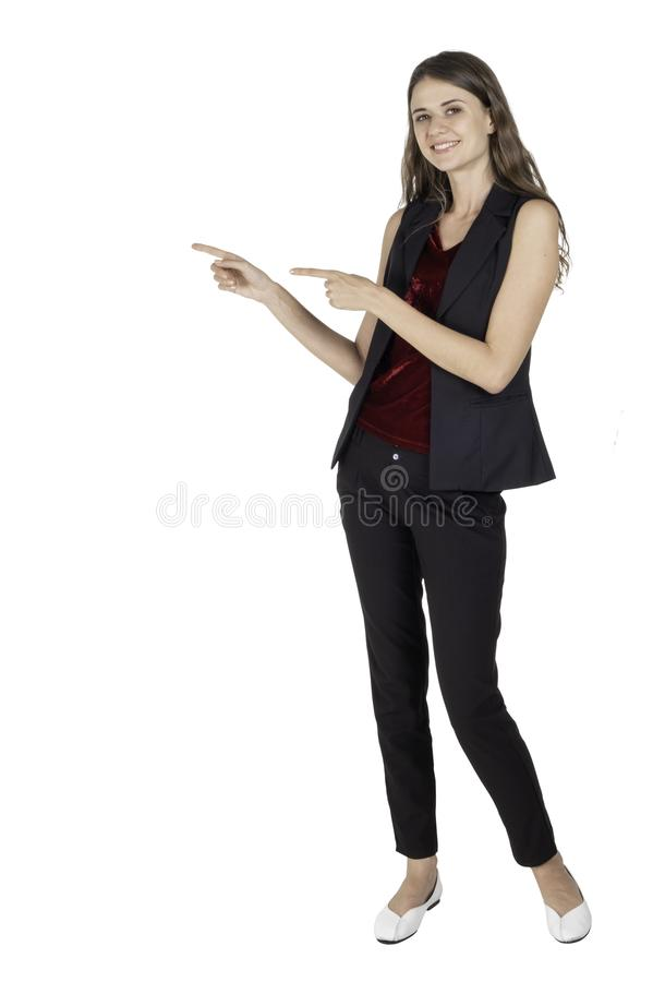 Full length of beautiful standing posing young woman and two hand pointing beside and looking straight at the camera stock photography