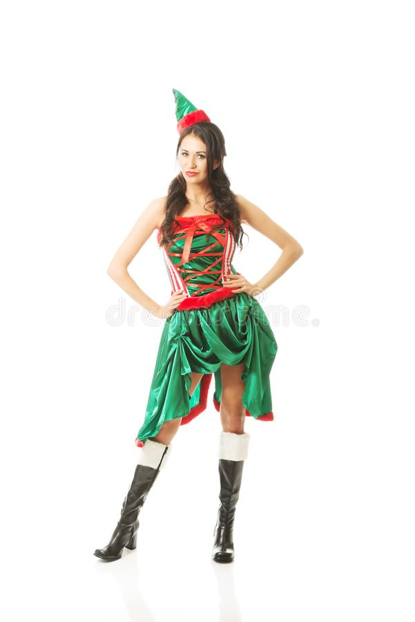 Full length beautiful woman wearing elf clothes, touching her hips stock image
