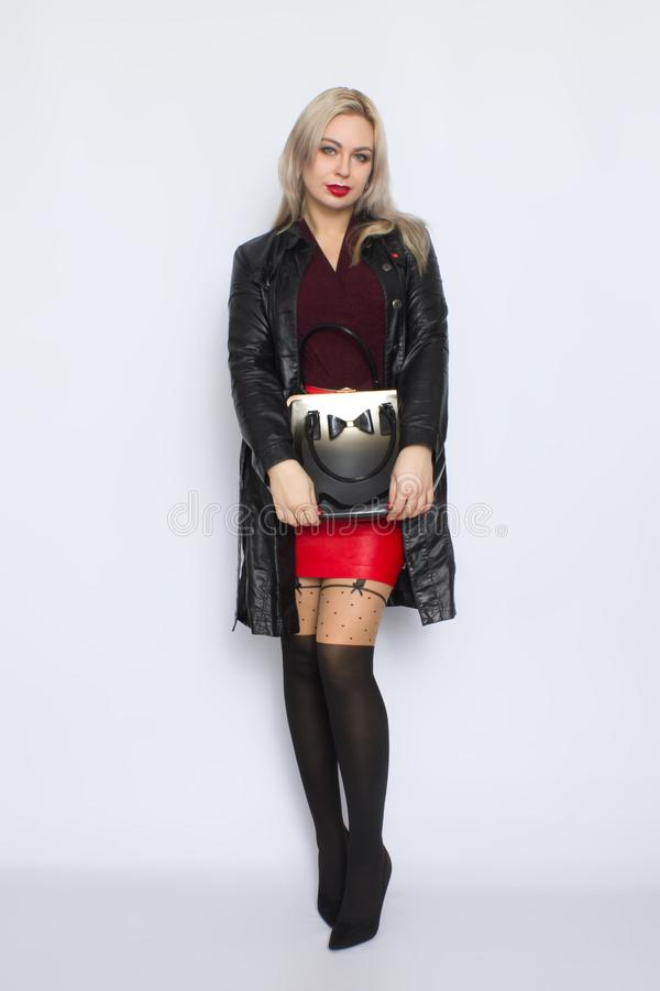 Full length blond holding bag in her hands stock images
