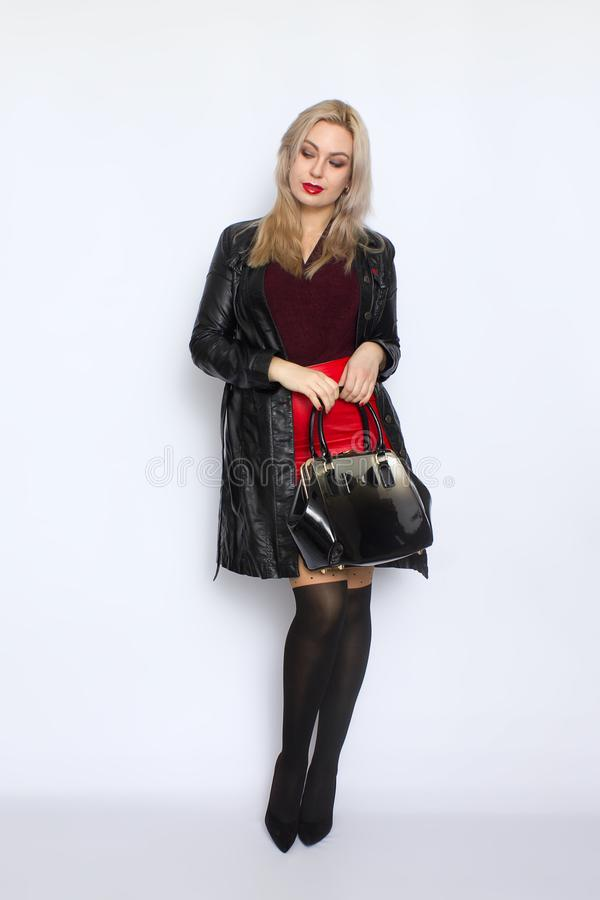 Full length blond holding bag in her hands royalty free stock image