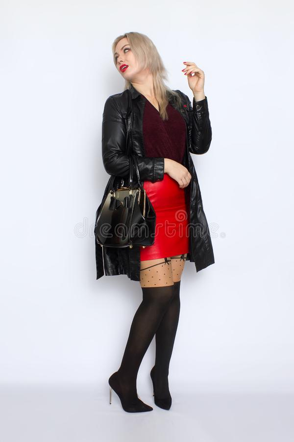 Full length blond holding bag in her hands stock photography