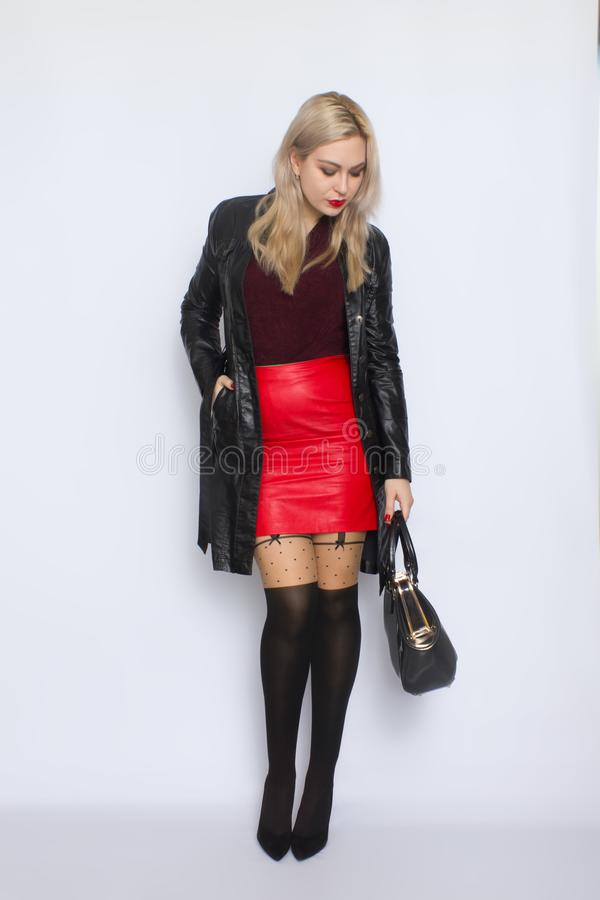 Full length blond holding bag in her hands stock image