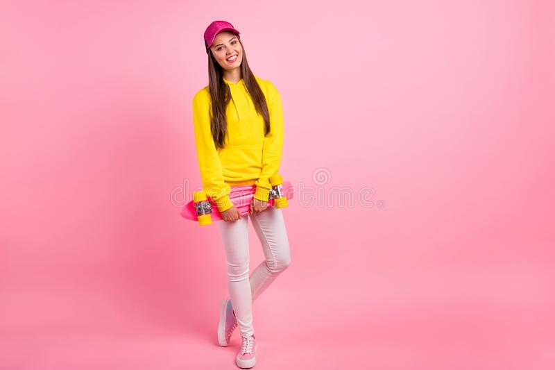 Full length body size photo of attractive trendy cute cheerful nice girlfriend wearing trousers yellow sweater holding. Full length body size photo of attractive stock photos