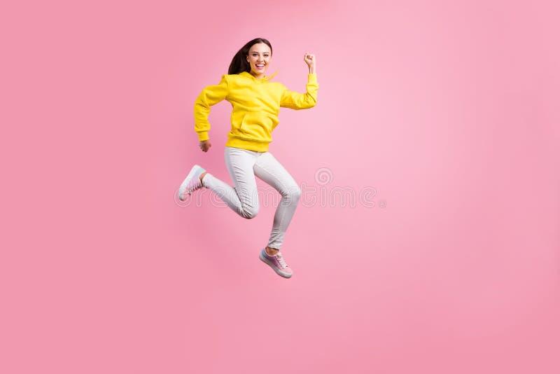 Full length body size photo of beautiful charming attractive cute girlfriend wearing yellow sweater running quickly. Full length body size photo of beautiful royalty free stock photo