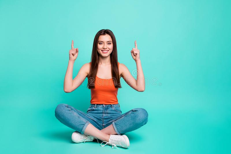 Full length body size photo beautiful her she lady sit floor crossed legs direct fingers empty space advise buy buyer royalty free stock photo