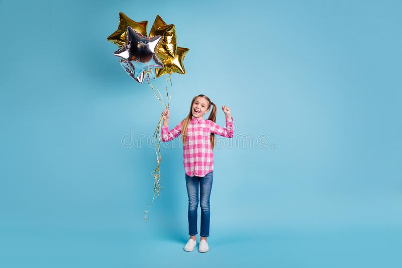Full length body size photo beautiful she her little hands arms golden silver balloons star shape figure festive gift stock photography