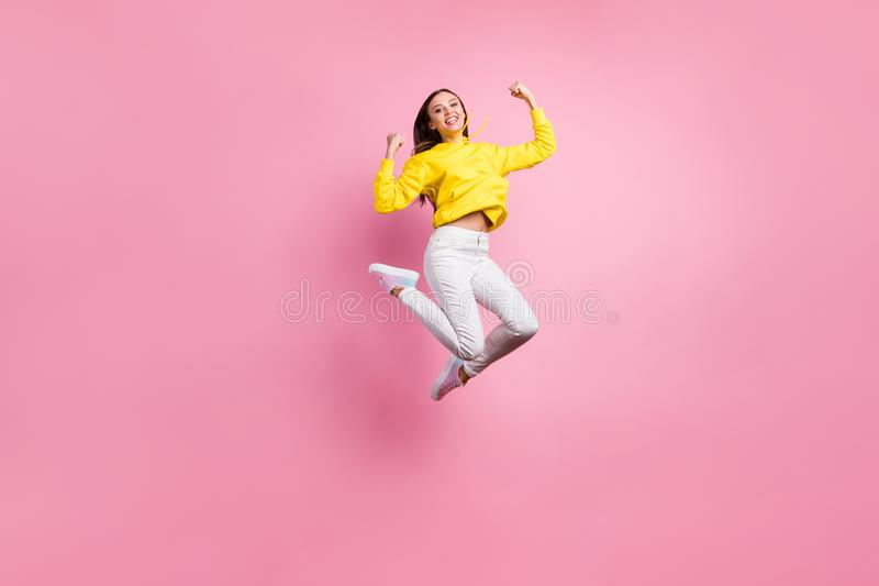 Full length body size photo of charming cheerful cute attractive girl having won some competitions while wearing yellow. Full length body size photo of charming stock photo