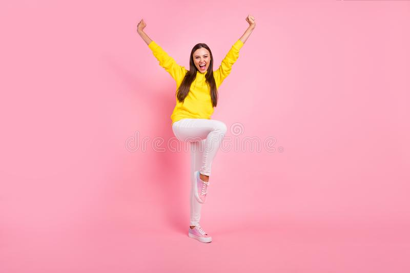 Full length body size photo of charming cute attractive nice pretty sweet lovely girlfriend raising her leg like jumping. Full length body size photo of charming stock image
