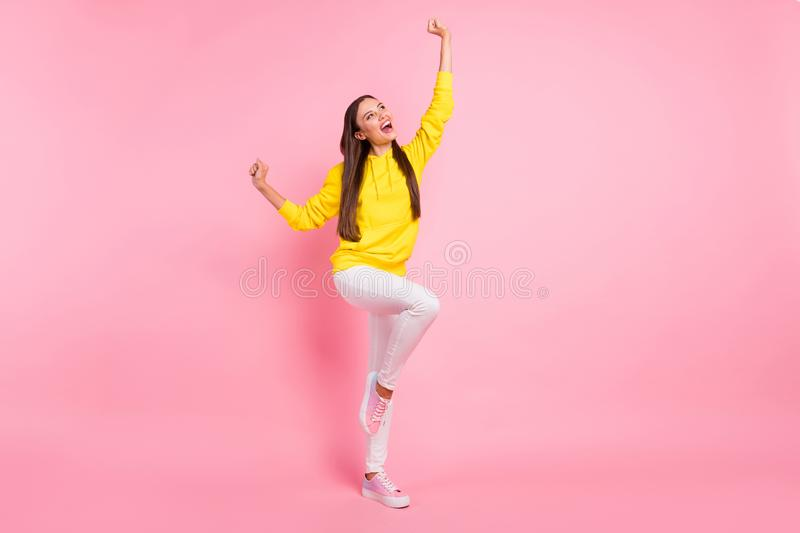 Full length body size photo of charming cute attractive pretty sweet lovely girlfriend dancing wearing yellow bright. Full length body size photo of charming stock images