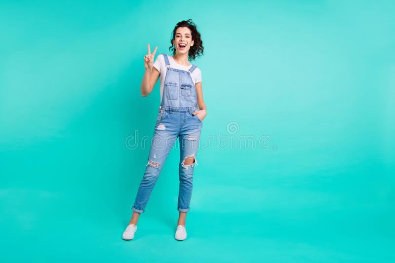 Full length body size photo of charming cute cheerful confident girlfriend with her hands in pocket of jeans overall royalty free stock photos